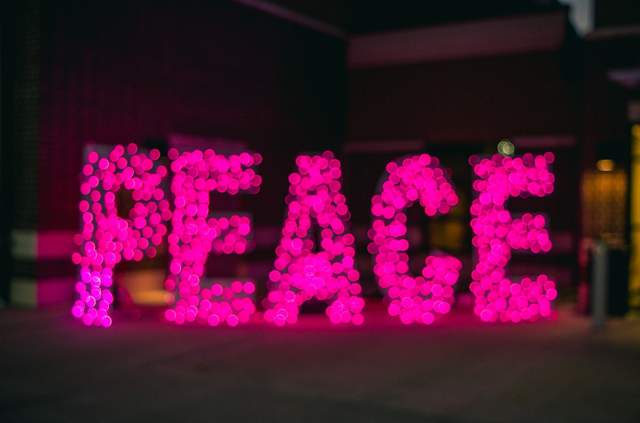 the word peace in pink